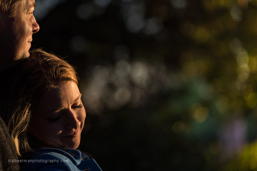 Profile of an engaged couple in Parsons Garden bathed in warm light in the Queen Anne neighborhood of Seattle