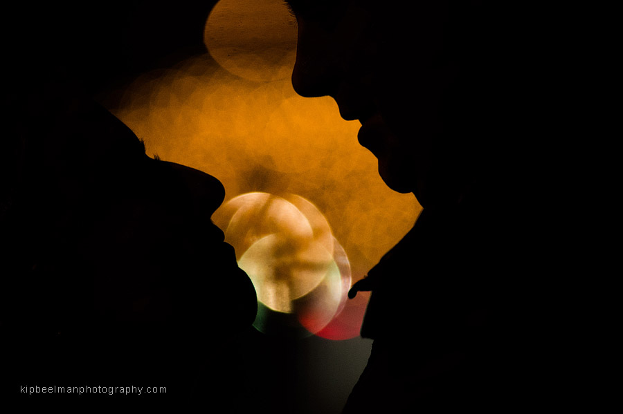 An engaged couple square off in a romantic and intimate moment for a dramatic silhouette