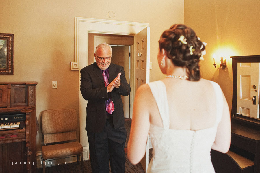 The father of the bride seeing her dressed in her gown for the first time ahead of her Glover Mansion wedding