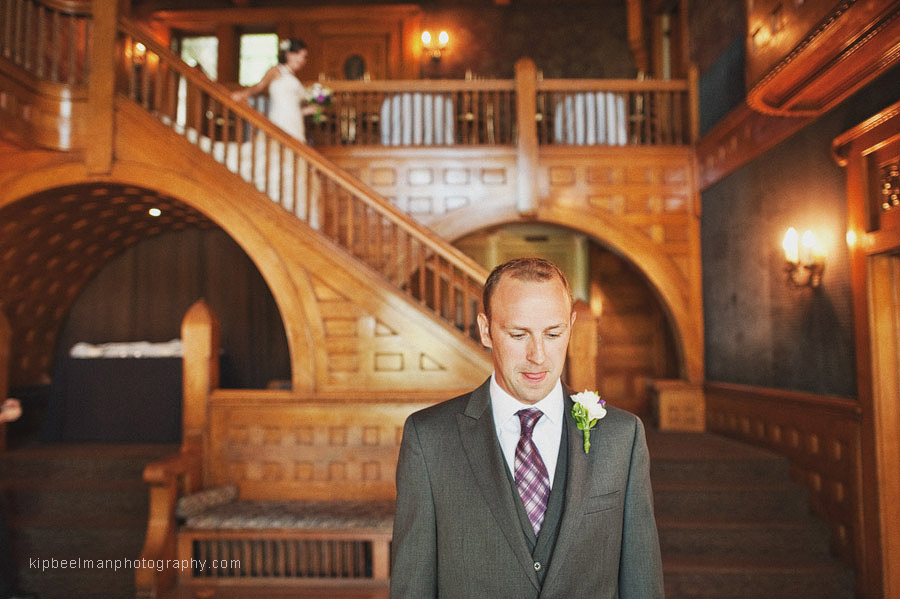 A groom waits anxiously as his bride approaches for their first look ahead of their Glover Mansion wedding