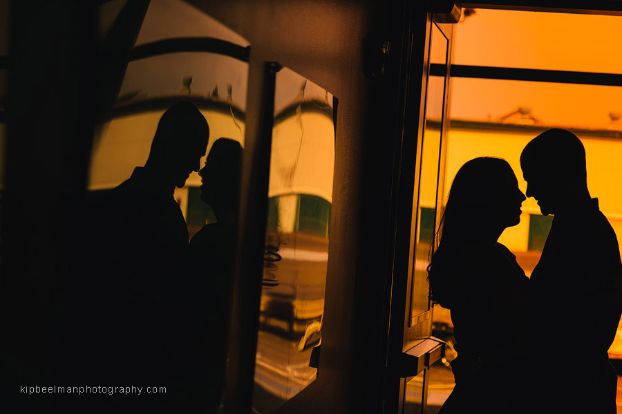 A moody silhouette of a couple embracing during their Fishermens Terminal engagement session