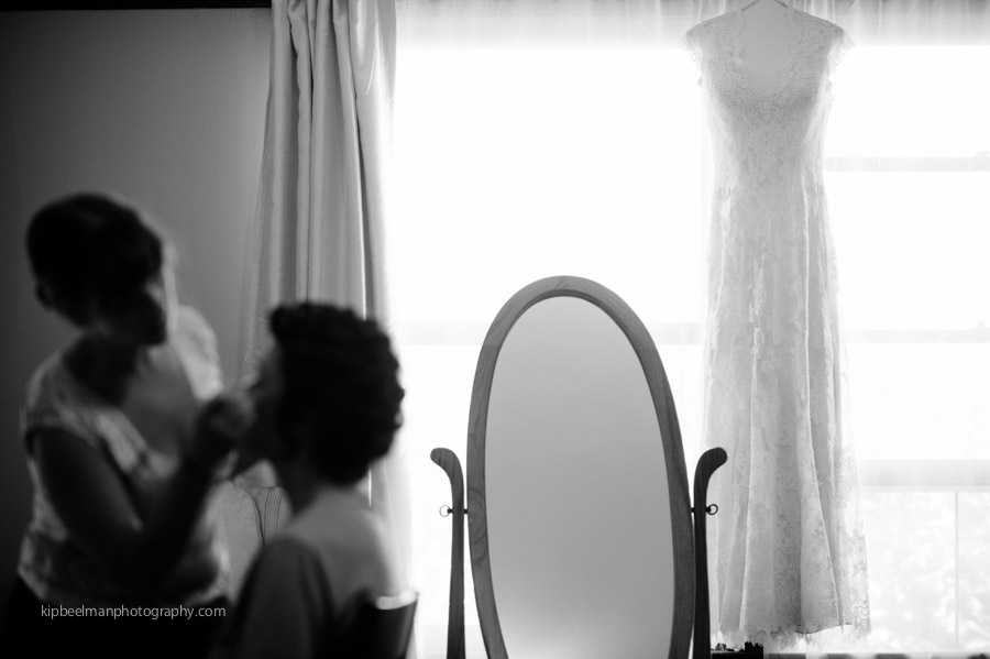 Black and White wedding dress hangs at the window
