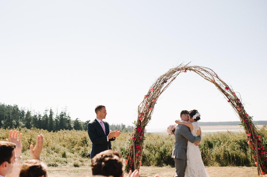 Bride and Groom under rose alter