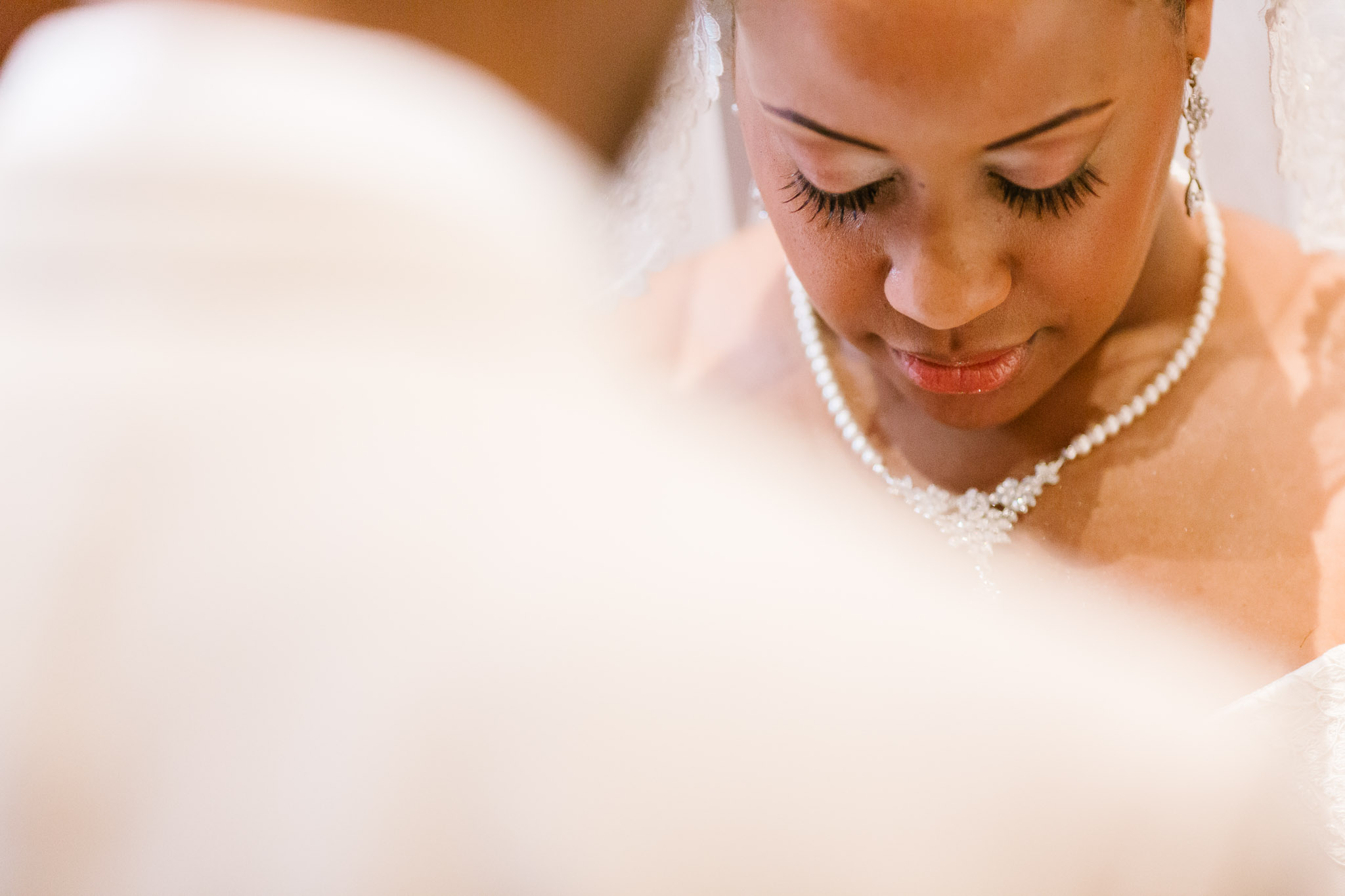 The bride engaged in a quiet moment during her Buffalo wedding ceremony