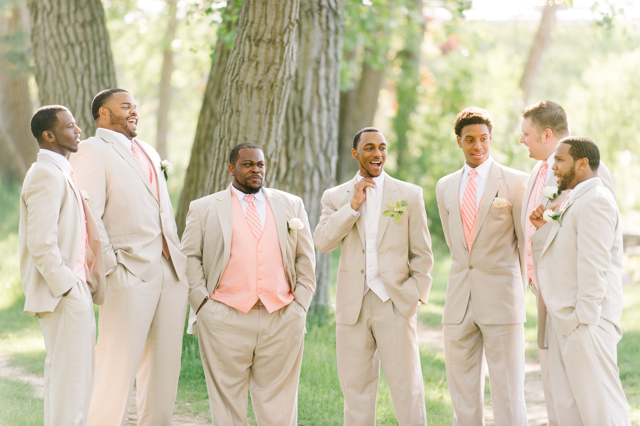 A groom and groomsmen laugh it up in a casual portrait taken at the Tifft Nature Preserve
