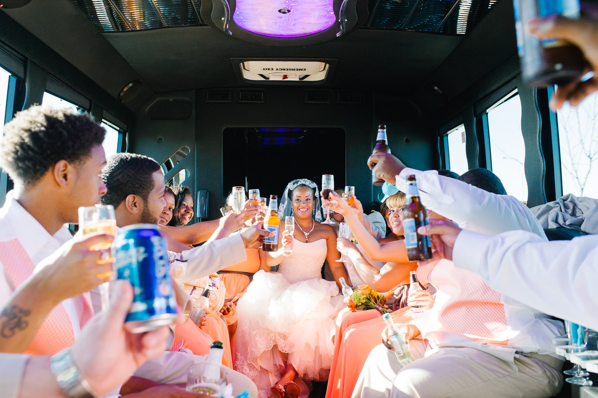 A Buffalo wedding party celebrate post-ceremony in a shuttle to Avanti Mansion