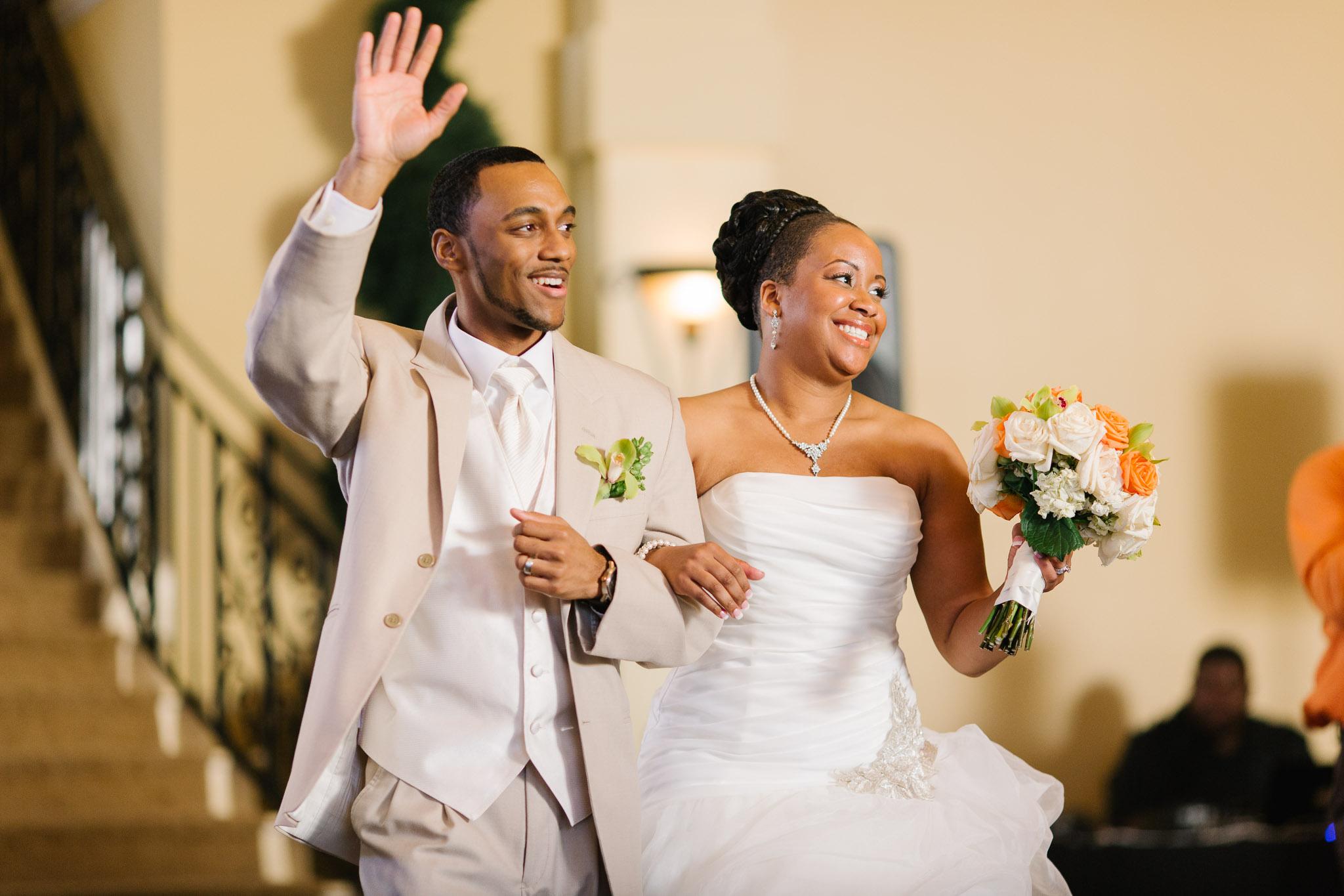 A Buffalo wedding couple enter their Avanti Mansion reception in grand fashion